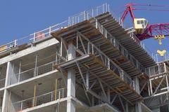 Crane Above Condo Building Stock Image