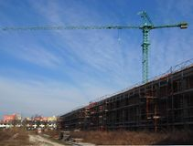 Crane above a new construction residential buildings Stock Photo