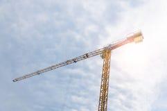 Crane against the blue cloudy sky. Crane against the blue cloudy sky Royalty Free Stock Photography