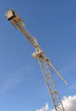 Crane against a blue sky Royalty Free Stock Images