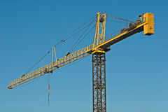Crane against blue sky Royalty Free Stock Photo
