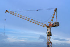 Crane  against blue sky. Royalty Free Stock Image