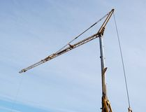 Crane against the blue sky Royalty Free Stock Image