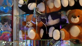Crane in amusement arcade in UK east coast seaside town. Crane to attempt to win cuddly toy in amusement arcade in UK east coast seaside town stock footage