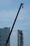 Crane andSkyscraper stock photography