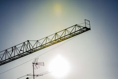 Crane and antenna at sunset Royalty Free Stock Photo