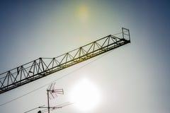 Crane and antenna at sunset Royalty Free Stock Photo