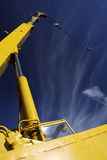 Crane arm. Against a blue sky Stock Images