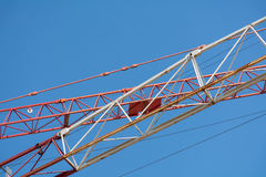 Crane arms diagonally against the blue sky Stock Photo