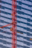 Crane attached to the skyscrapper Stock Image
