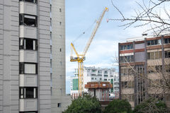 Crane in Auckland CBD with apartment buildings and office blocks Royalty Free Stock Photo