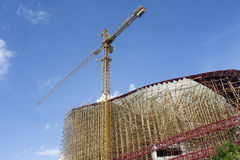 Crane and bamboo scaffolding Stock Photography