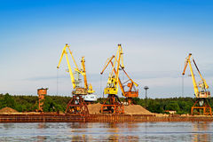 Crane and barge. Port bulk crane and barge Stock Image