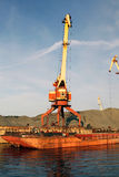 Crane and barge. Port bulk crane and barge Royalty Free Stock Photo