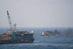 Crane barge doing marine heavy lift installation Stock Photos