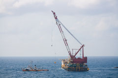 Crane barge doing marine heavy lift installation Stock Photo
