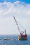 Crane barge doing marine heavy lift installation Royalty Free Stock Photography