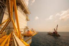 Crane barge doing marine heavy lift installation Royalty Free Stock Image