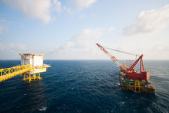 Crane barge doing marine heavy lift installation Royalty Free Stock Photos