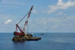 Crane barge lifting heavy cargo or heavy lift in offshore oil and gas industry. Large  boat working for lift piping Stock Photos