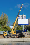 Crane and billboard Stock Photography