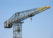 Crane on blue background. At a sea port. Isolated object Stock Photo