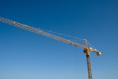Crane and blue sky. Industrial crane with blue sky background Stock Images