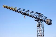 Crane on blue sky background. Isolated object Stock Photos