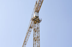 Crane on blue sky background Stock Photos