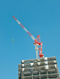 Crane with blue sky background Stock Photo