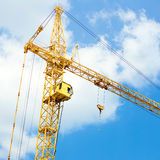 Crane on blue sky background Royalty Free Stock Photo
