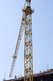 Crane on blue sky background Royalty Free Stock Photos