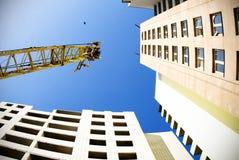 Crane on blue sky with bird. Crane with building on blue sky with bird Royalty Free Stock Image