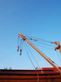 Crane in the blue sky. Cargo crane  at the pier in bright blue sky Stock Photo
