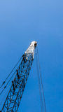 Crane on blue sky Stock Photo
