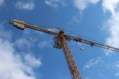 Crane in blue Sky. Photo of a yellow crane in a blue sky on a construction site in brittany france Stock Photography