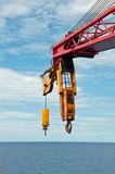 Crane Boom and Hook over the Sea Stock Image