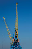A Crane boom with main block and jib against Stock Photography