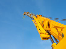 Crane. Boom of mobile crane with blue sky background Royalty Free Stock Photo