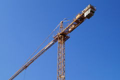 Crane bottom view with blue sky background Stock Photo