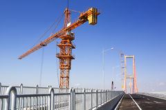Crane in bridge area Royalty Free Stock Photo