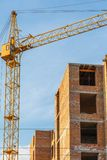 Crane build multi-storey residential house. Stock Photo