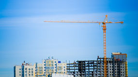 Crane and building. On a background blue sky Stock Photo