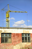 Crane over old building Stock Images
