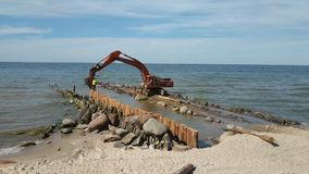 Crane building barriers at sea stock footage