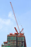 Crane and building construction Royalty Free Stock Image