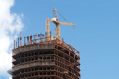 Crane in building construction activity process Stock Photography