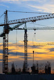 Crane of building construction against beautiful dusky sky Royalty Free Stock Image