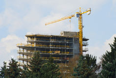 Crane and building construction. big building construction Royalty Free Stock Images