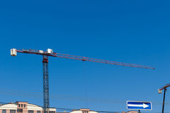 Crane and building construction on blue sky background Royalty Free Stock Photo